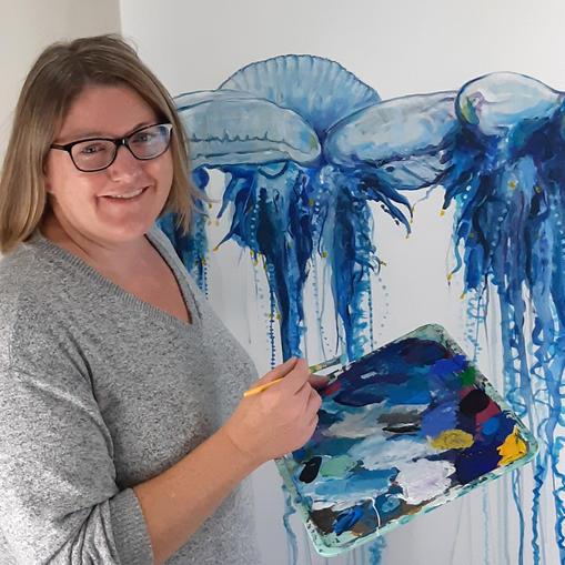 Naomi painting in her studio 2021