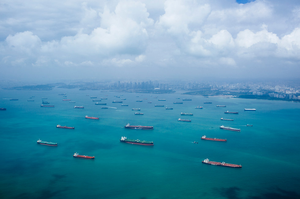 high-angle-view-of-barges-and-cargo-ship
