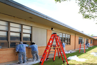 Removing Asbestos Containing Window Caulk from School