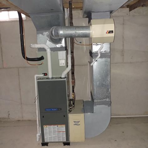 American Sandard, Silver, 95% efficient forced air furnace.