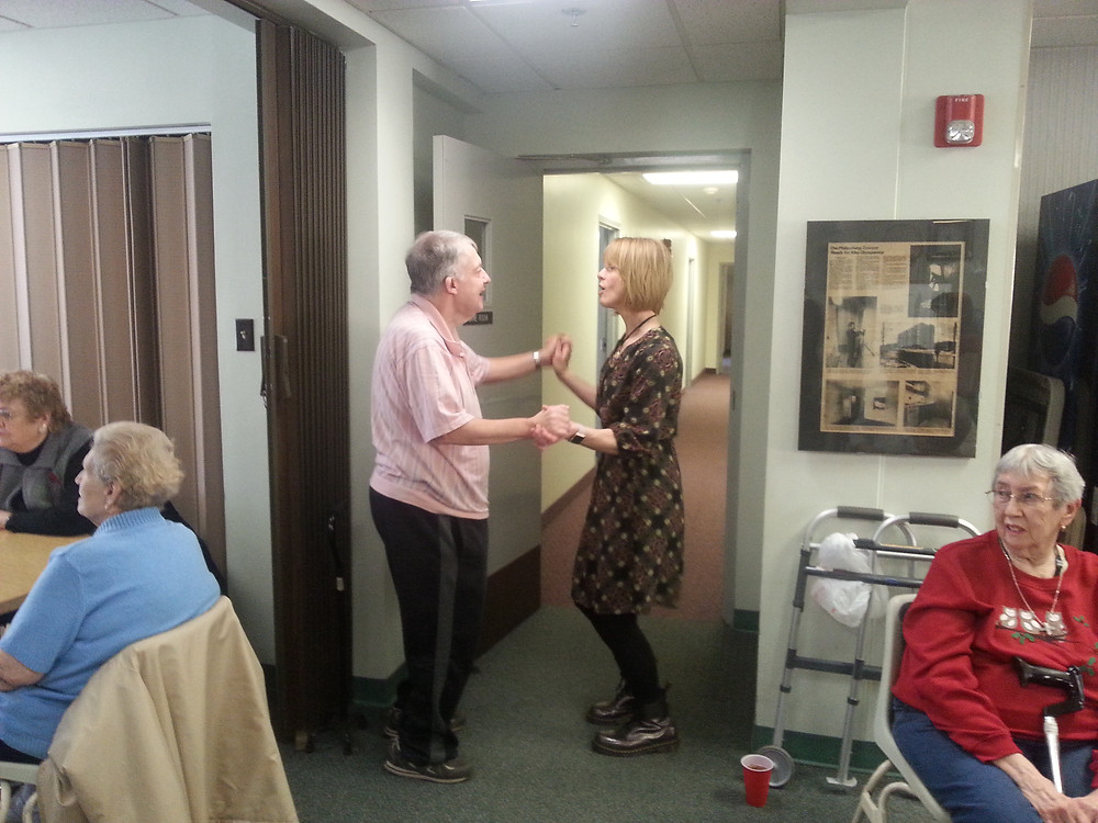 Dr. Christy Phillips dancing with one of the attendees