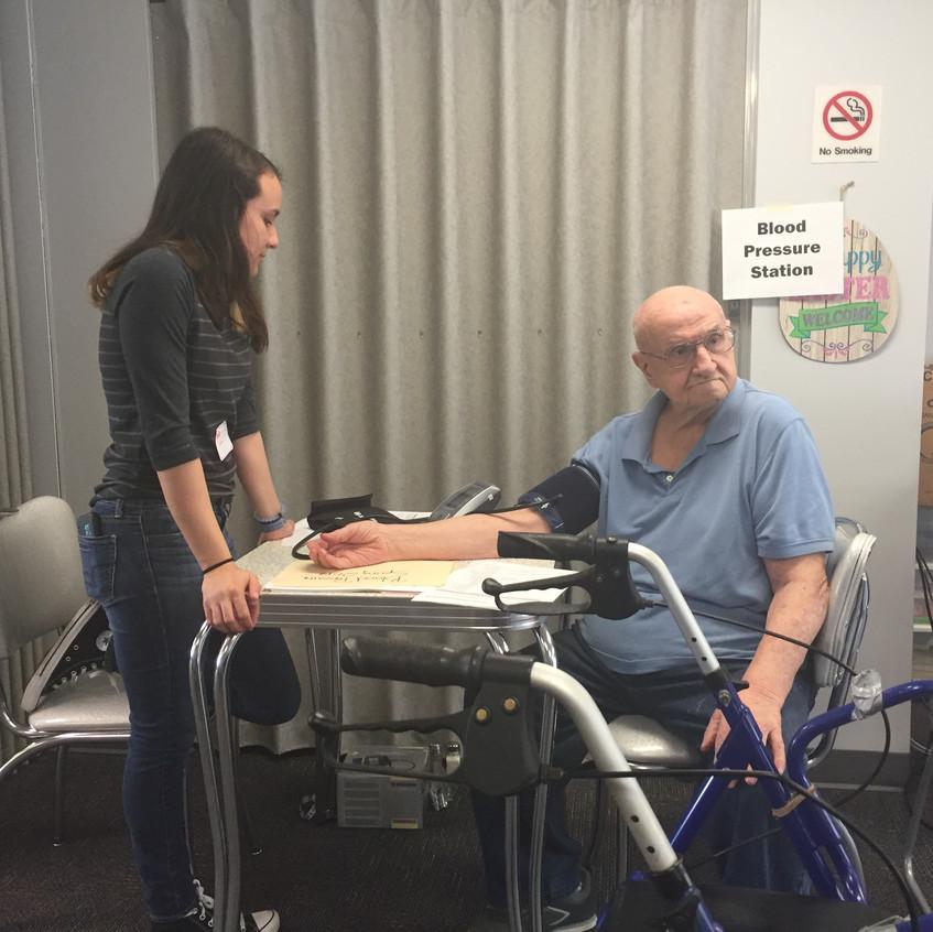 SHAARP member Elaina takes the blood pressure of a Philipsburg resident, Mr. Butterworth.