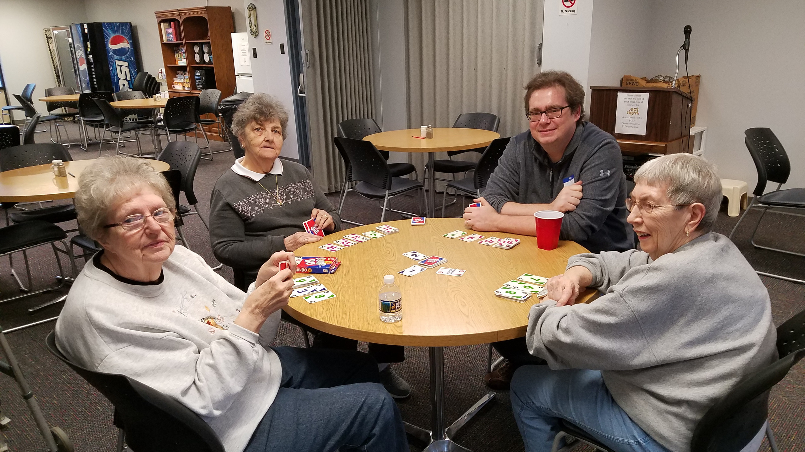 Jeff playing a competitive game of cards with Philipsburg residents Ms. McGlone, Mr. Conklin, and Ms. Bair.