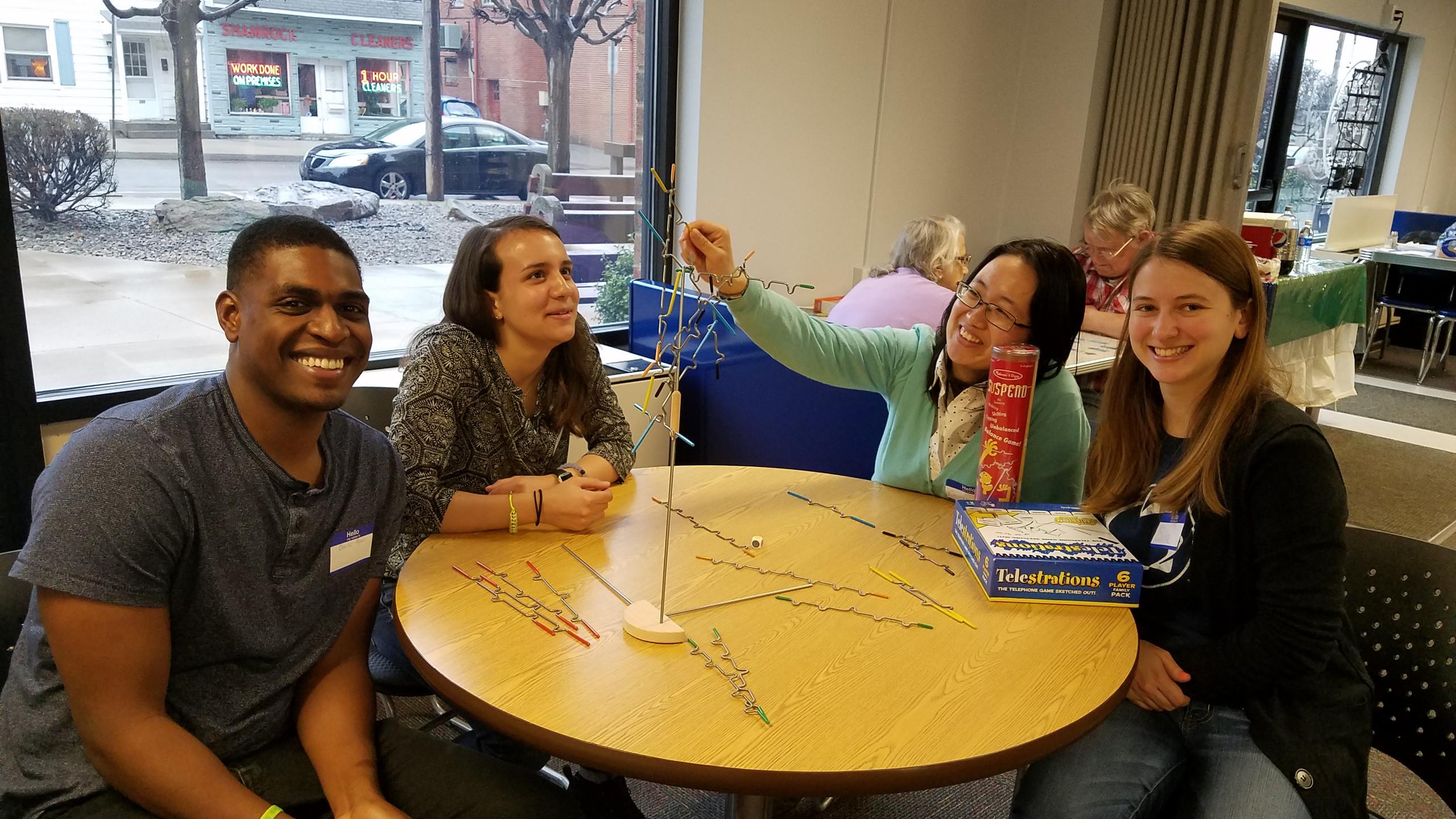 Lab members Charles, Elaina, Dr. Chongming, and Sara enjoy a game of Telestrations