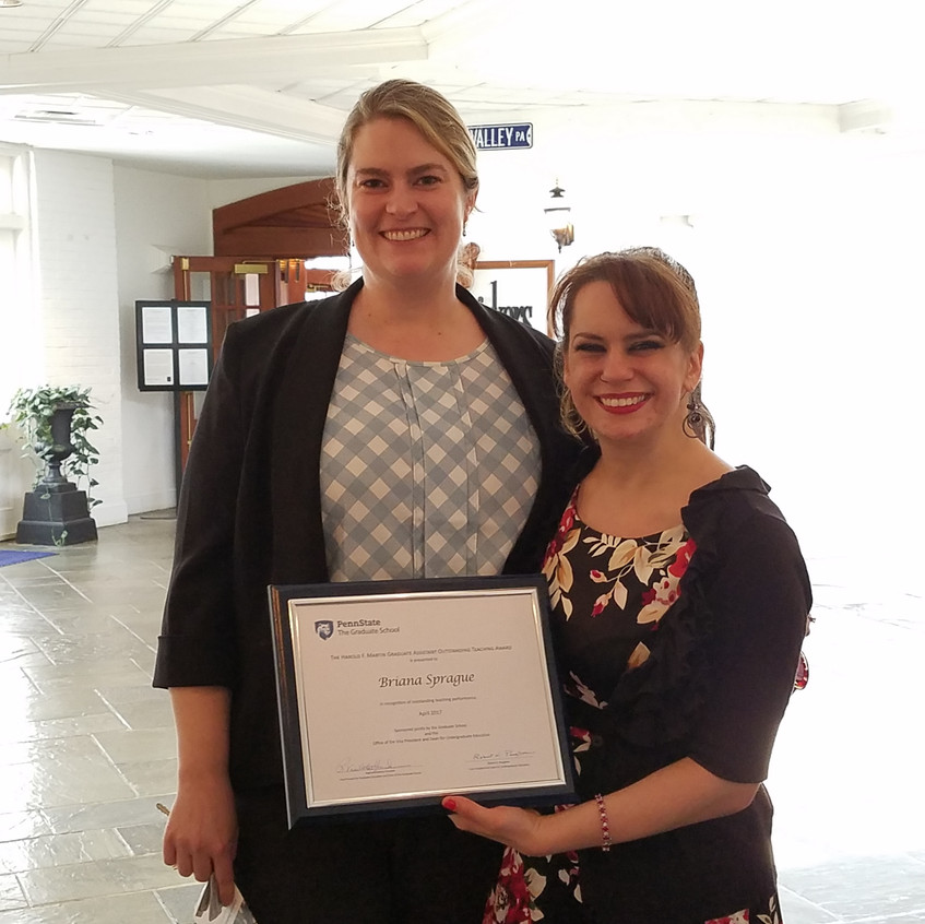 Graduate student Briana Sprague and Dr. Ross at the award ceremony.