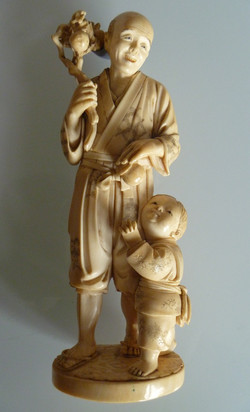 Oriental+Carved+Ivory+Horn+Okimono.jpg