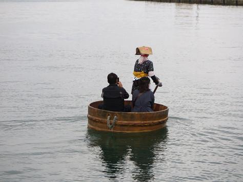 Tarai-bune boats are used to catch fish on the ragged coast of Sado Island.