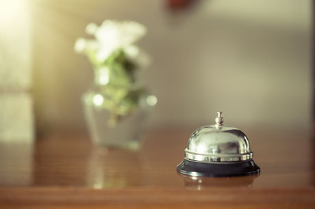 Vintage bell on reception desk on sunset