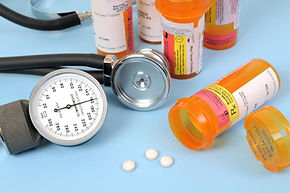 bottles-of-pills-with-a-stethoscope-and-