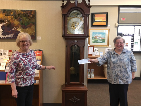 Ruth Davis presents MUTPL with $1,000