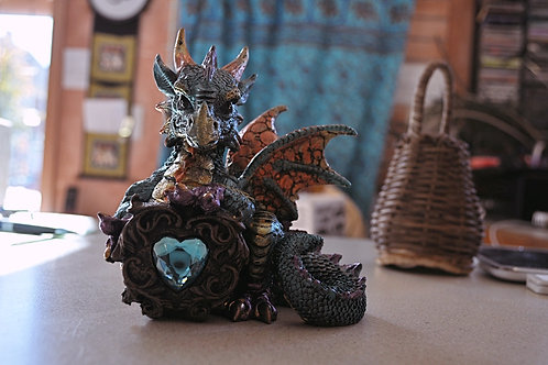 Dragon holding faux crystal