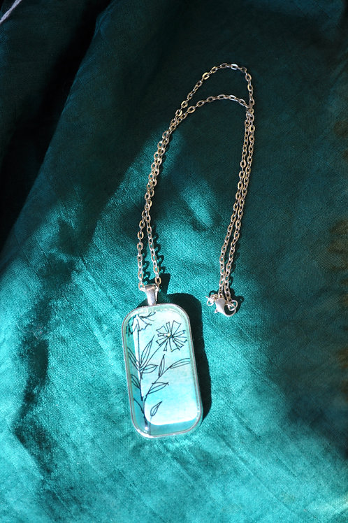 Locally crafted Zentangle inspired color wash blue necklace in glass.