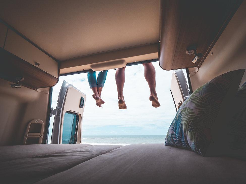 couple in a camper van on the beach.jpg