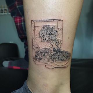 Teeny tiny Raisin Bran cereal tattoo for