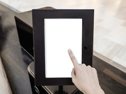 A woman using touch screen mock up of ki