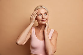 portrait-of-mature-elderly-european-woman-touches-face-gently-has-perfect-skin-and-looks-t