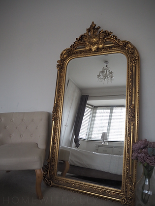 Large free standing gold mirror
