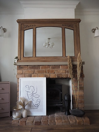 Large heavy French antique over mantle mirror in raw wood
