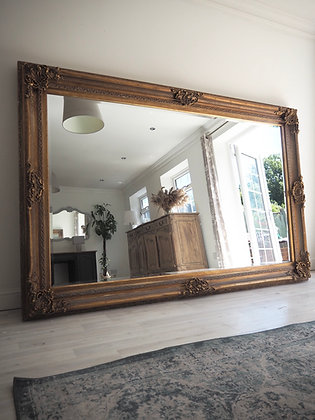 Very large freestanding vintage gold ornate mirror