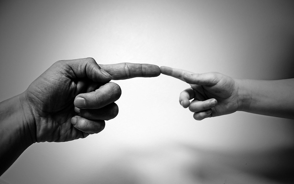 Michelangelo-style touching fingers