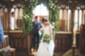 Sage & co floral design white and green floral arch wedding
