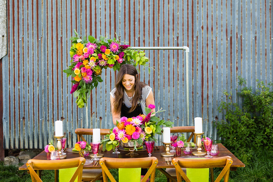 Founder of Sage & Co, Vanessa, arranging flowers