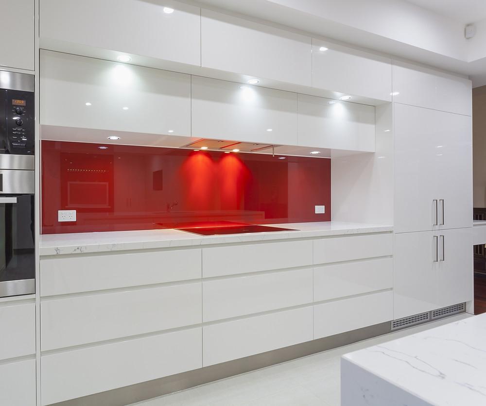DIY Shadowline kitchen with contrasting red splash-back