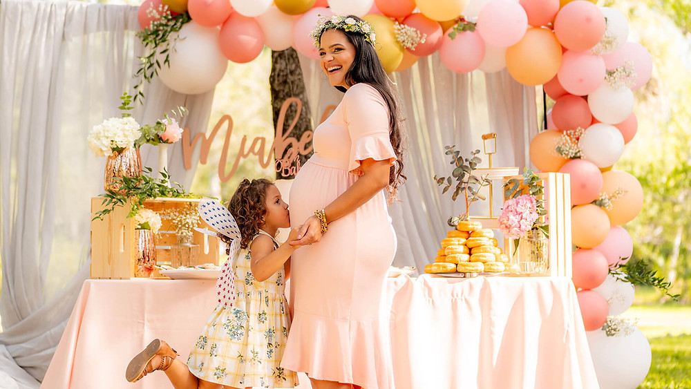 A mom and her daughter at her baby shower