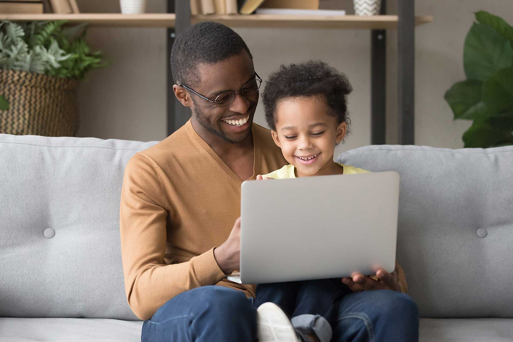 A father and son on their laptop with vidday