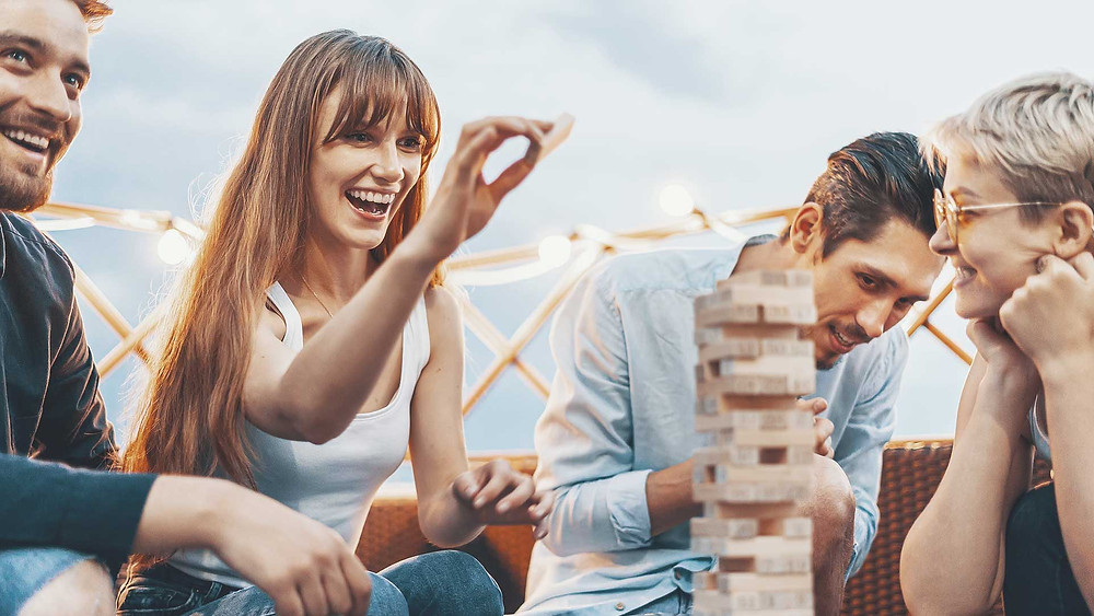 friends playing jenga together