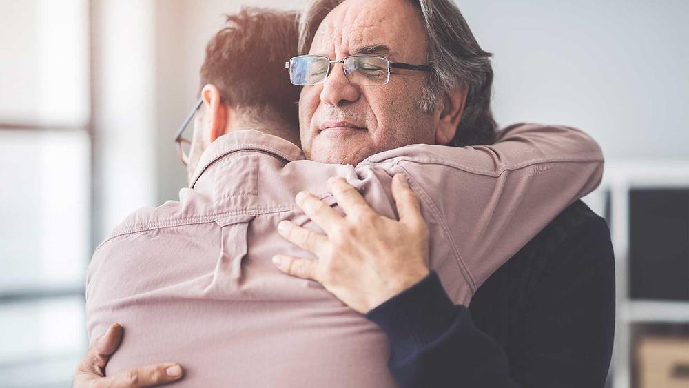 A son hugging his dad