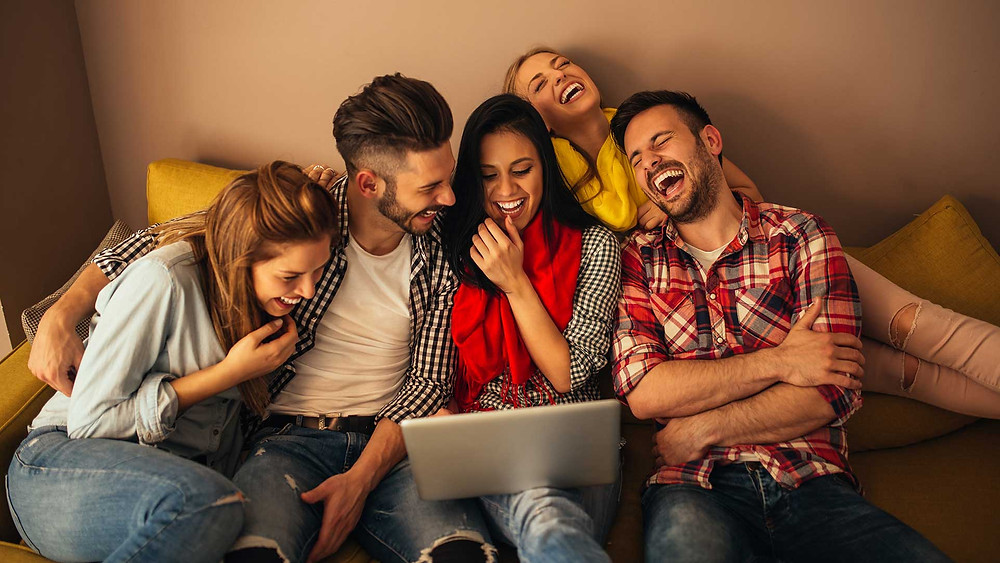 A group of friend watching vidday on a couch
