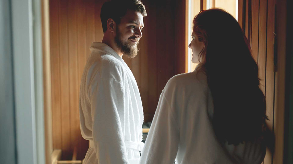 a couple in robes at a spa