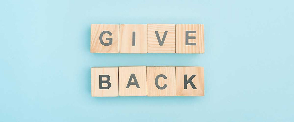 "There are scrabble pieces that spell out ""Give Back"". Because giving a donation in your Mom's name is a great Mother's Day gift idea."