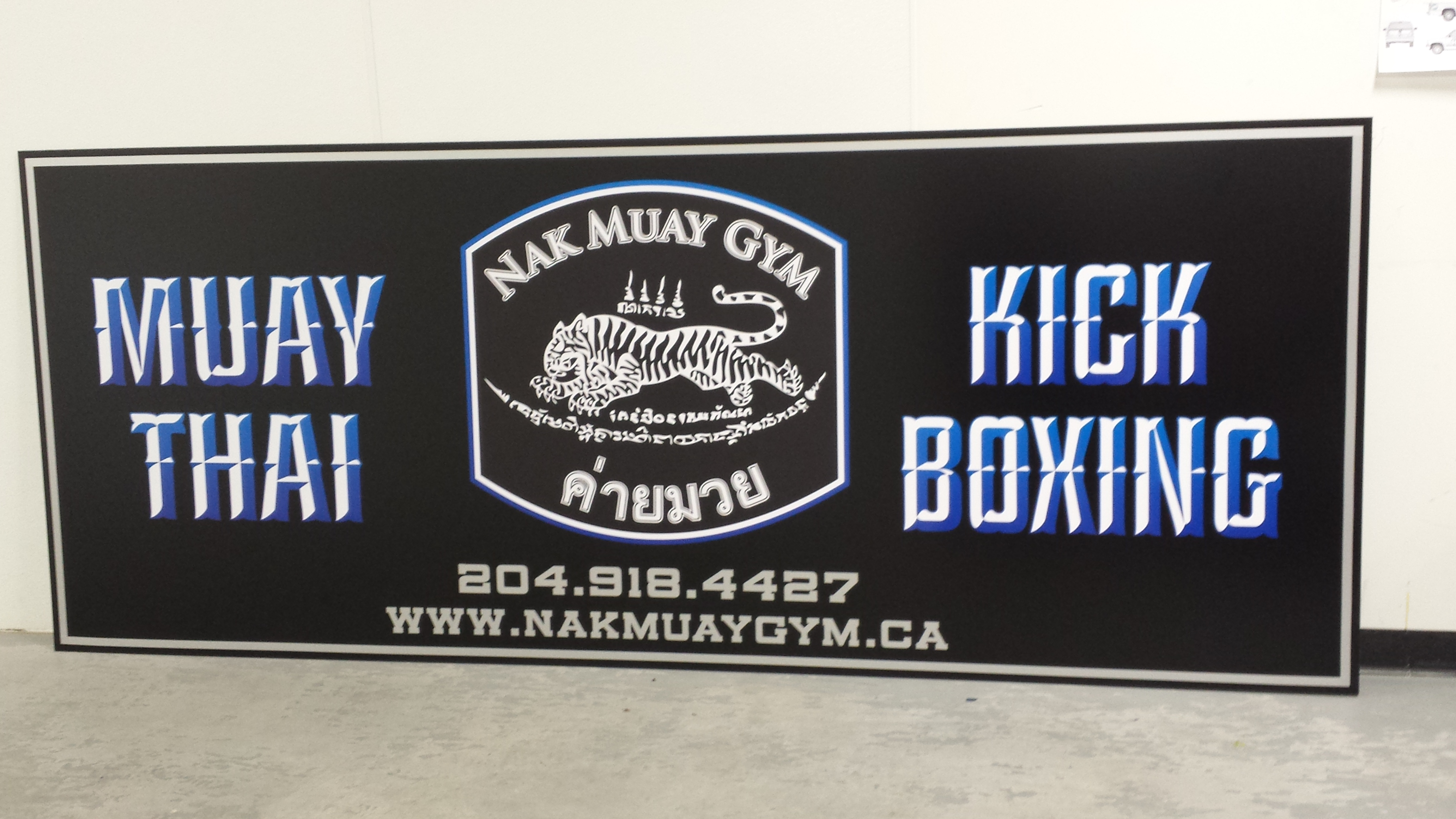 Building sign with matte & gloss vinyl overlays
