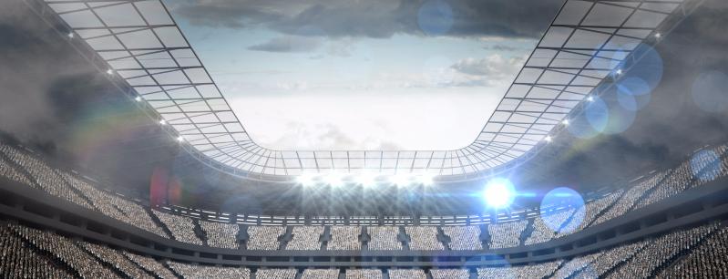 Large football stadium with lights under cloudy sky_edited_edited.jpg
