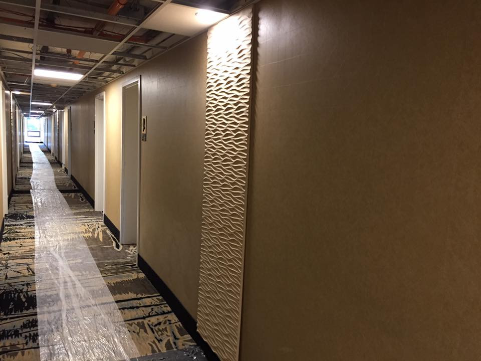 Hallways after with vinyl wall covering