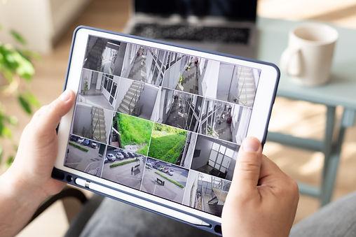 man-monitoring-modern-cctv-cameras-digital-tablet-indoors-surveillance-security-system.jpg