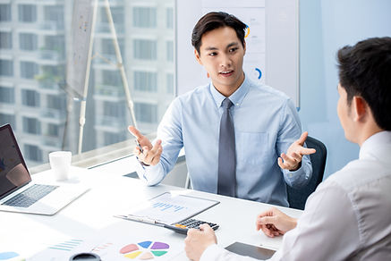 financial-broker-explaning-business-data-his-client.jpg