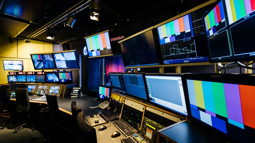 An image of a media studio with dozens of screens