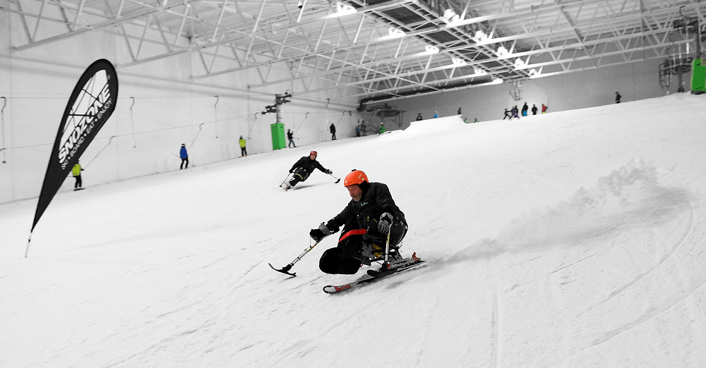 A skier on a mono-ski at Snozone