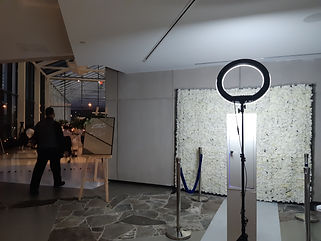 Tower booth with flower wall.jpg