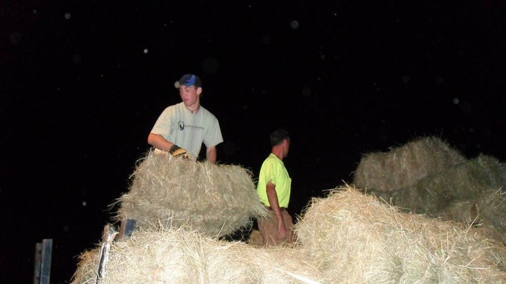 Colton & Brandon unloading and stacking hay for SHERR
