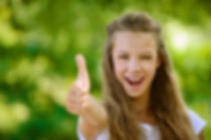 Teen girl with thumb up.jpg