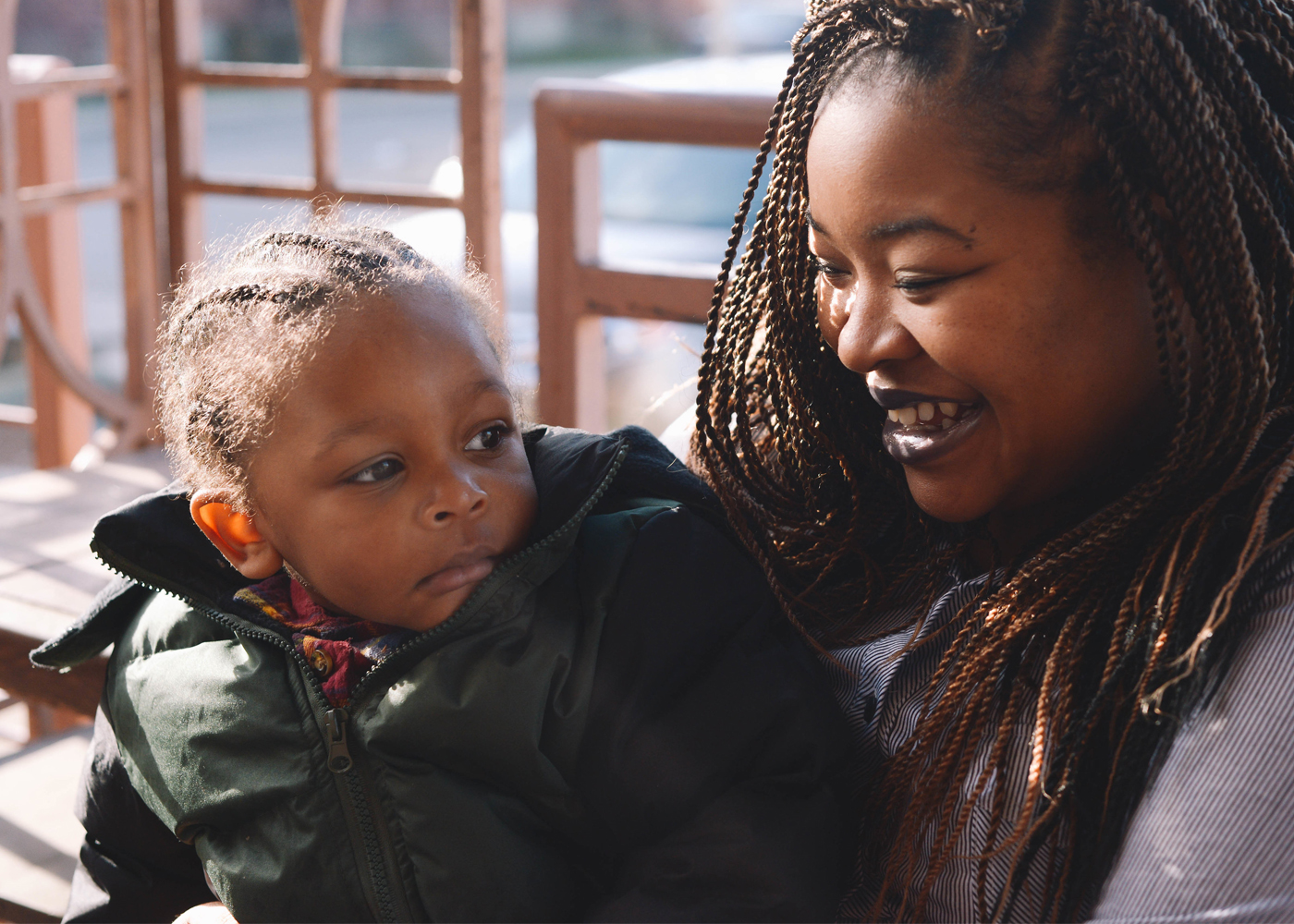 African American mom holding child