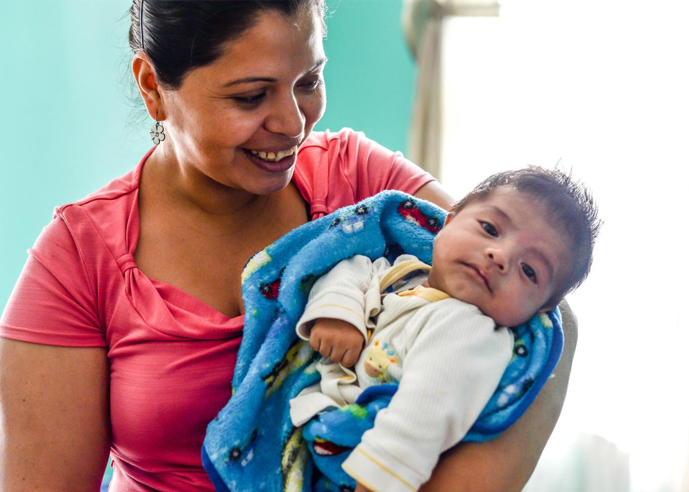 Hispanic Lady holding baby