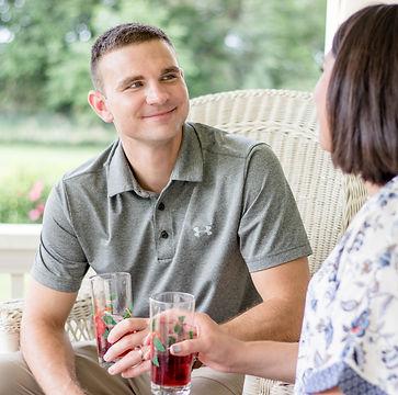 Guests enjoying beverage on porch