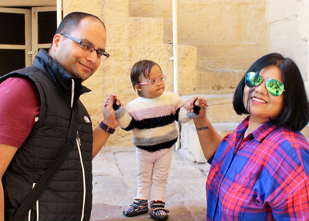 Indian Family with their Downs Syndrome Toddler