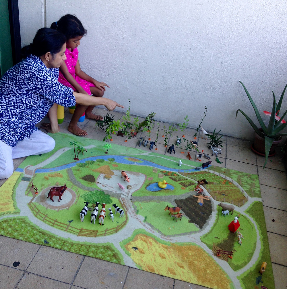 Nibbles playing mixed media jungle with her grandmother