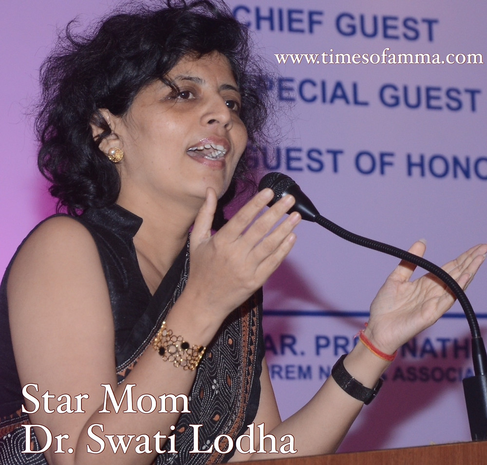 Times Of Amma Star Mom Dr. Swati Lodha talking at a conference